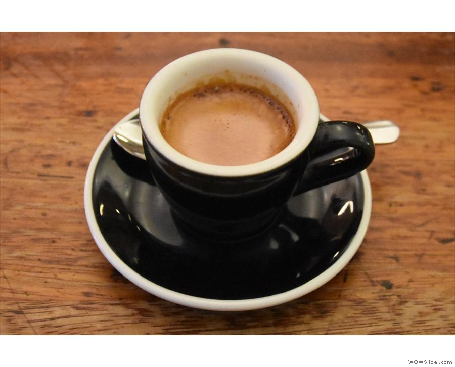 Here's my espresso, in a classic black cup...