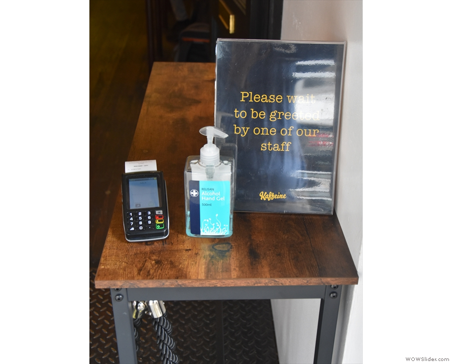 ... with a card reader (for payment), hand sanitiser and a polite notice asking you to wait.