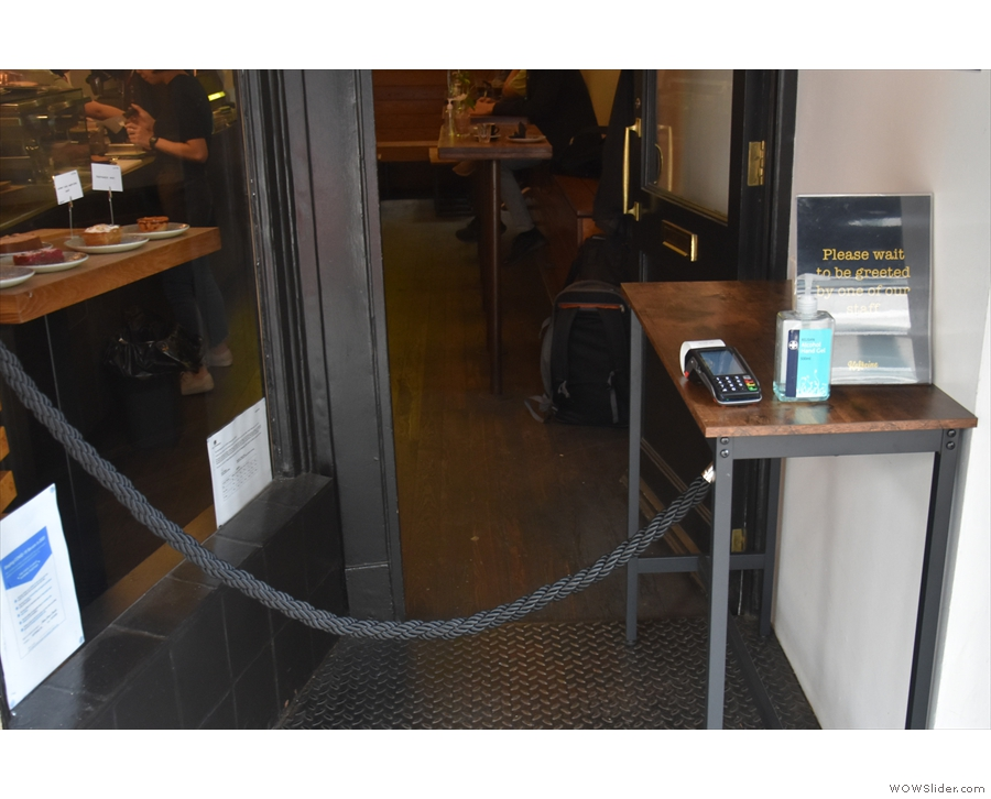 ... halted by a rope across the entrance. There's a small table to the right...