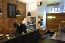 The interior of Kaffeine is very familar. The counter is on the left, with tables on the right...