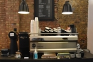 ... while at the far end is the Synesso espresso machine and its grinders.