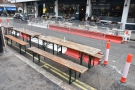 ... to add three long, thin tables with benches at the side of the road.