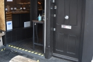 This joins the existing outdoor seating, with a single bench to the right of the door...