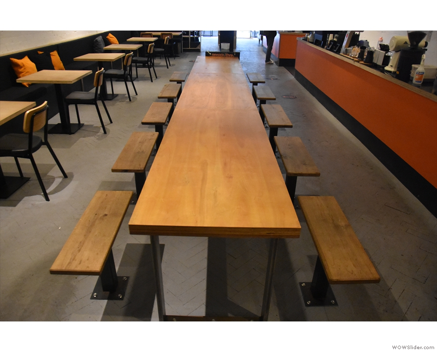 ... has been replaced by this long table with benches either side.