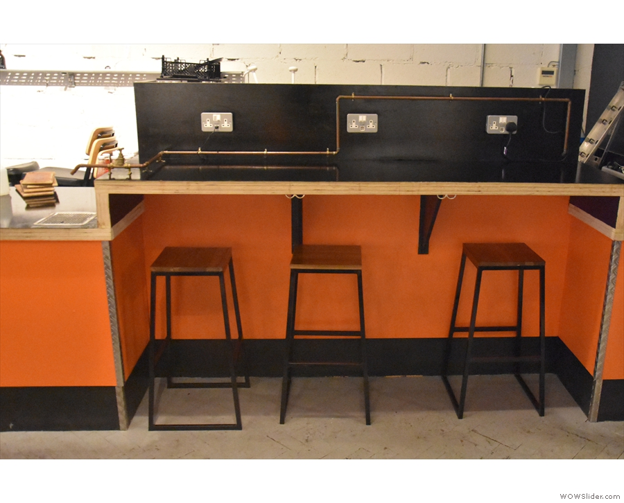 The three-person bar at the far end of the counter is still there though...