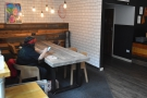 ... now has a single, six-person table rather than the armchair/sofa combination.
