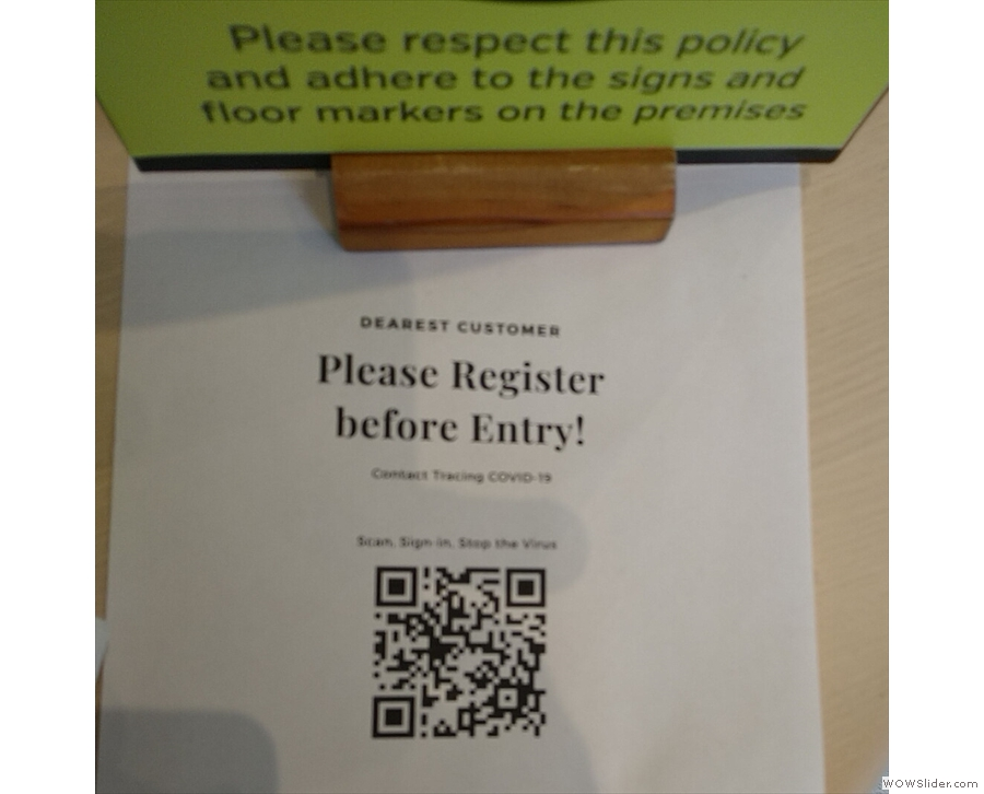 As well as the hand santiser, there's a QR Code to scan, so you can register your details.