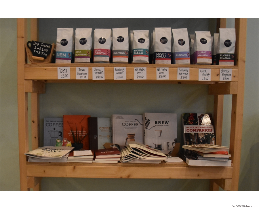 As well as books, the bookcase now also houses the retail shelves...