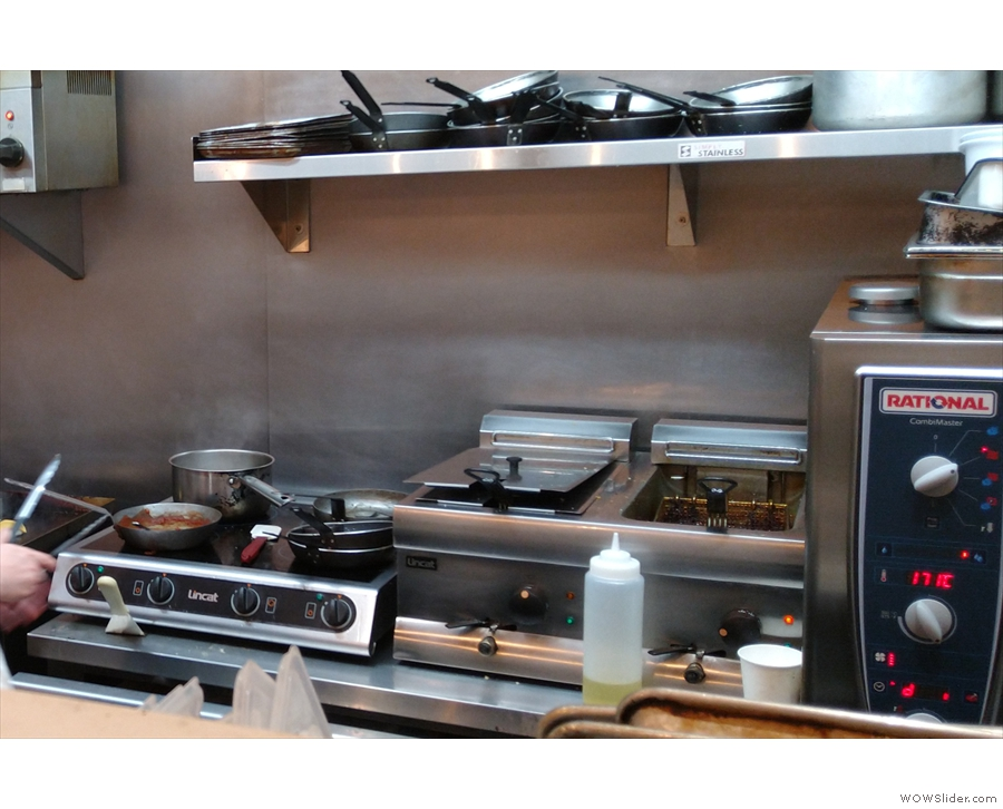 ... with all the food being prepared in the open kitchen at the back.