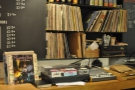 ... behind which is an old-fashioned turntable, along with a record library (from 2013).