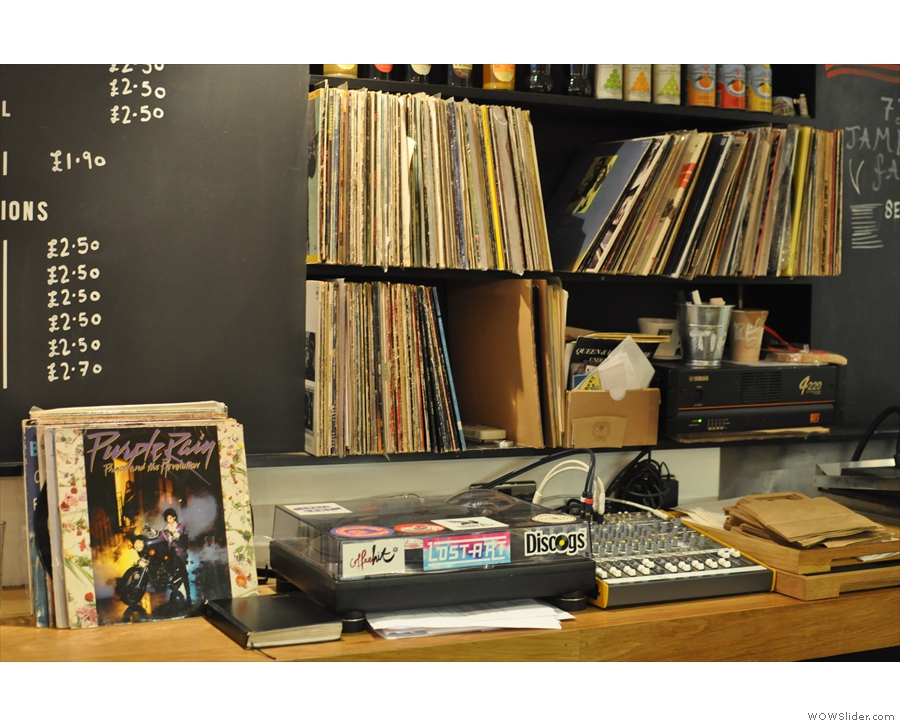 ... is a turntable, along with a library of vinyl records, source of the background music.