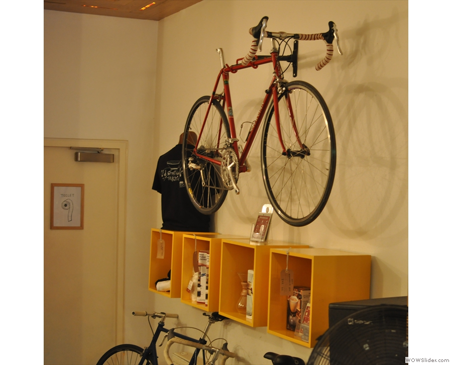 Opposite, continuing a theme of bicycles and coffee, a racing bike hangs on the wall.