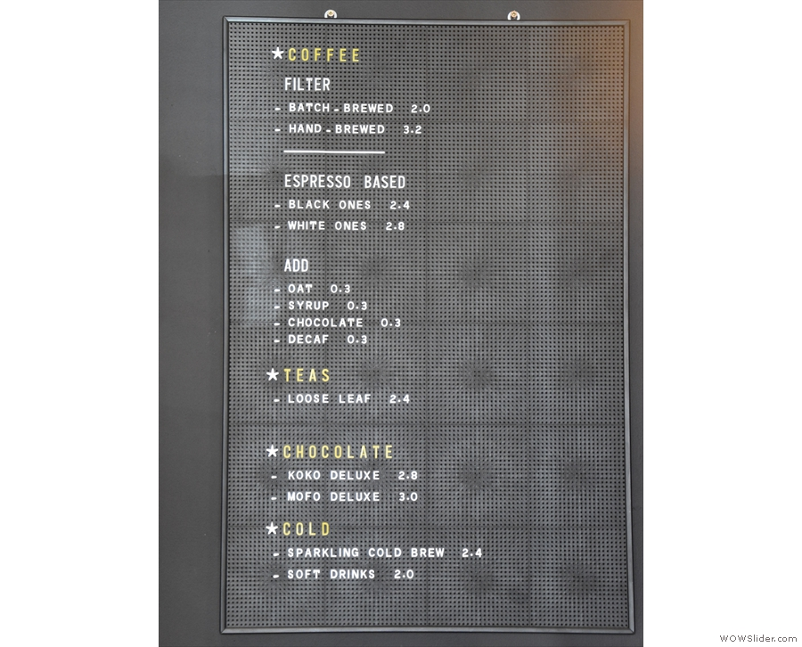 ... and the concise drinks menu on the back wall.