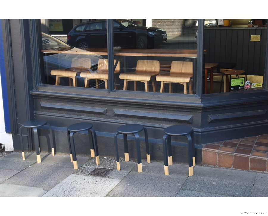 ... and four low stools on the pavement for any hardy folks who want to sit outside.