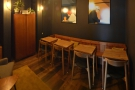 ... which is much as it was before, with the row of four two-person tables along the...