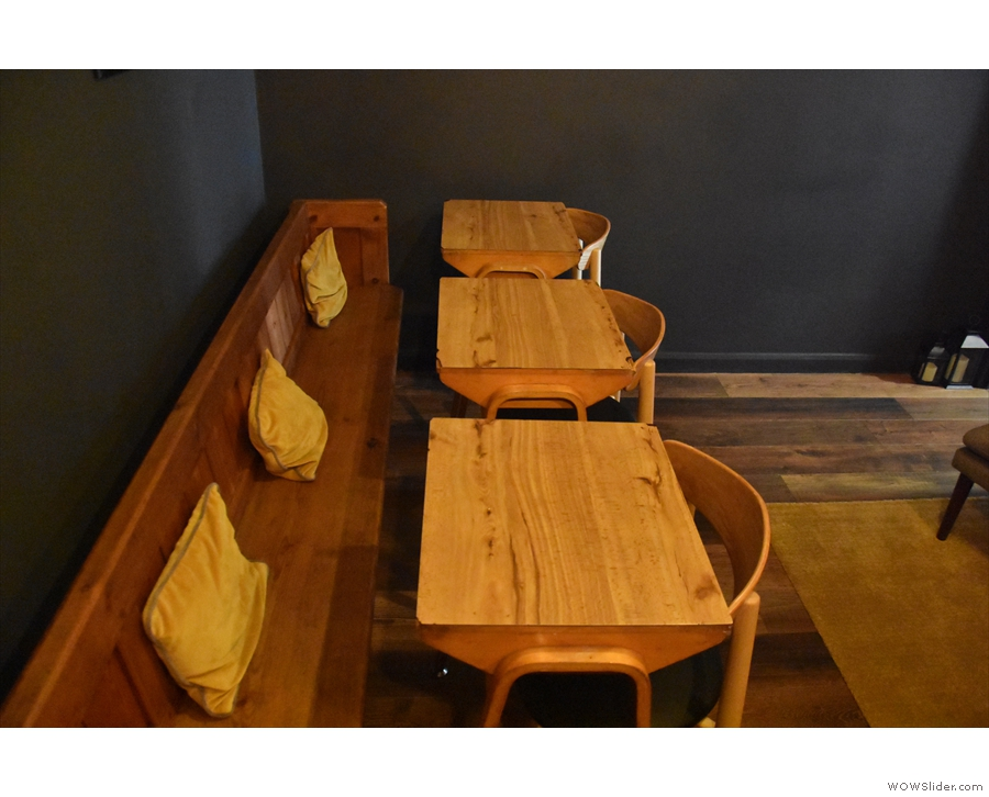 ... a wooden bench against the back wall...