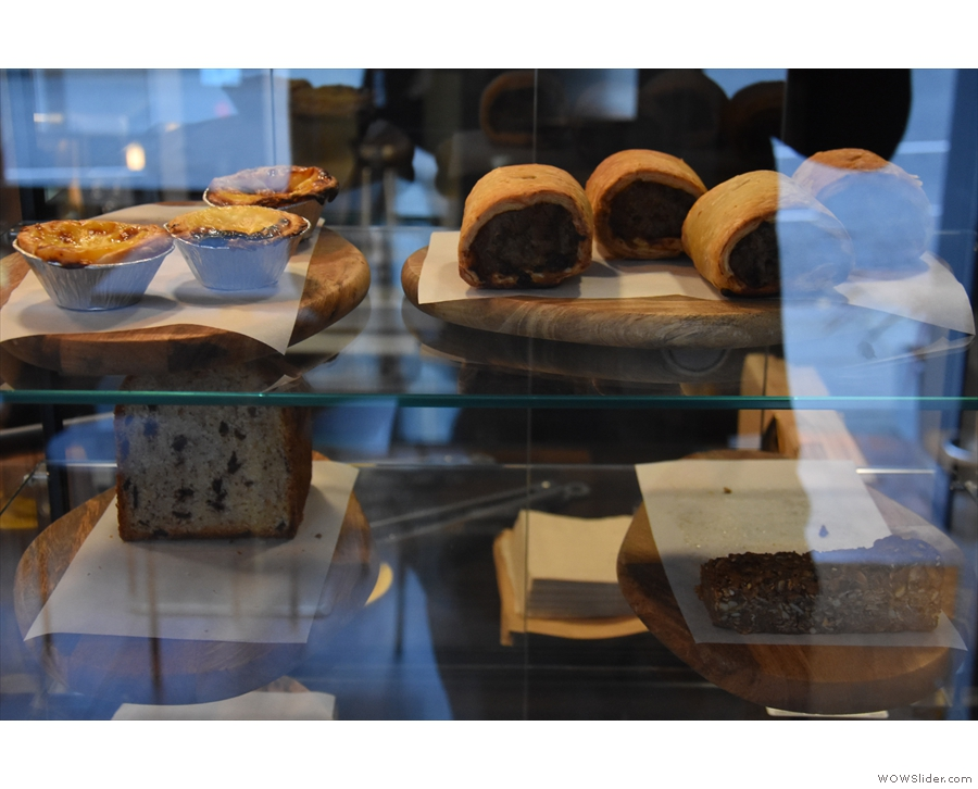 ... cakes and pastries on the right-hand side, behind the obligatory Perspex screens.