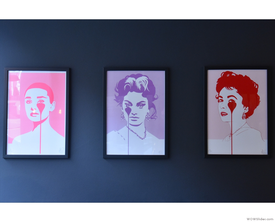 Meanwhile, there are three similar portraits on the left-hand wall, all by artist Pure Evil.