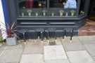 ... with four low stools on the pavement for any hardy folks who want to sit outside.
