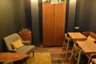 And here's a view down the length of the (admittedly short) back room. But what's that...