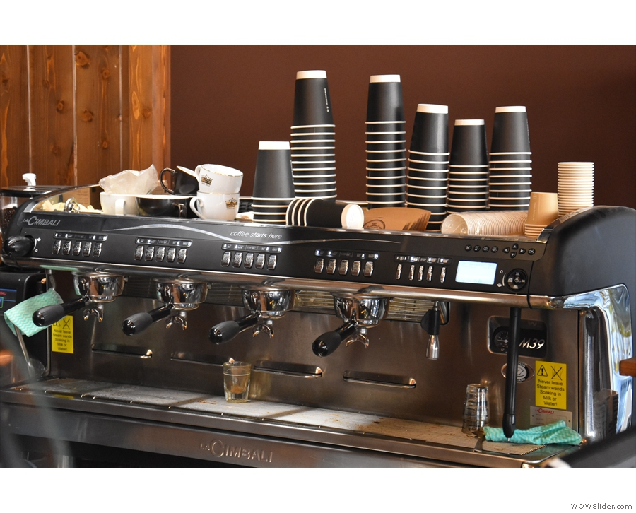I, of course, came for coffee, made with this four-group espresso machine. For now, it's...