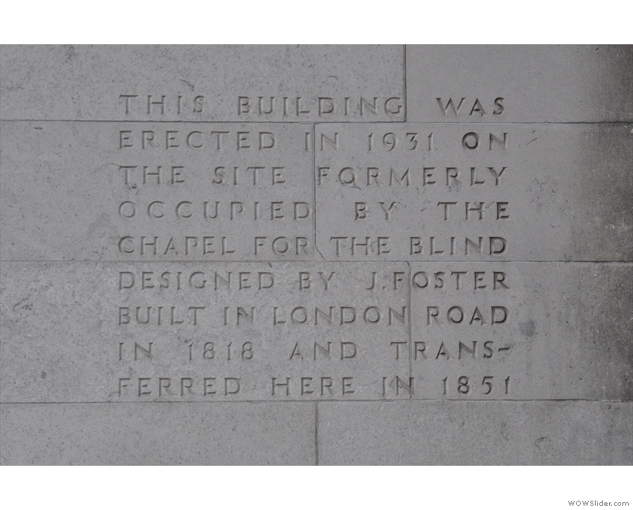 An inscription on the wall explains the building's heritage.