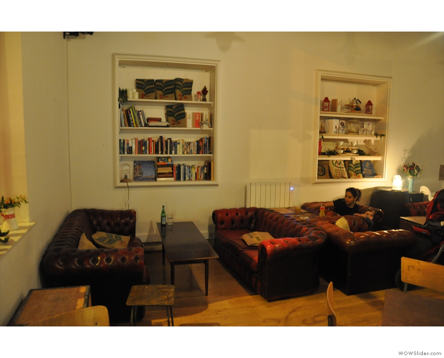 The comfy chairs come next, then the sofas. The book shelves are a nice touch.