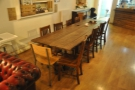 This long, communal table, for example, has moved to the far end...