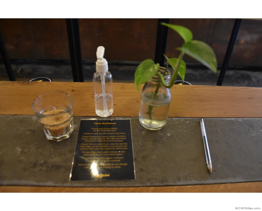 ... head to a table, where you'll find individual hand sanitister and some instructions.