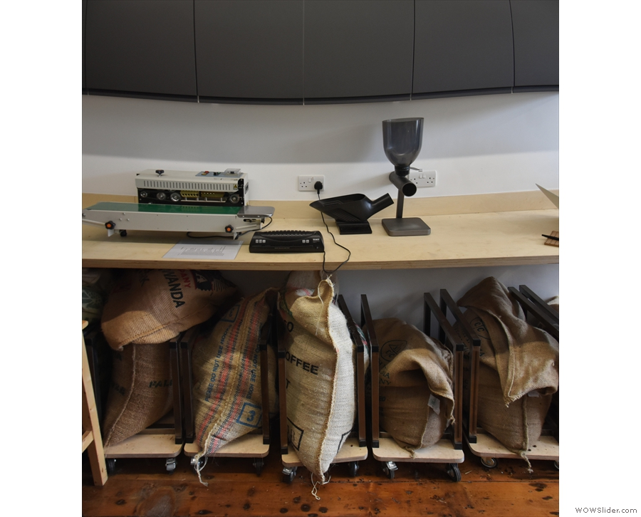 ... bagging area to the right, with opened sacks of green beans stored underneath...
