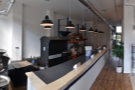 Originally the roastery was behind this counter on the left-hand side...