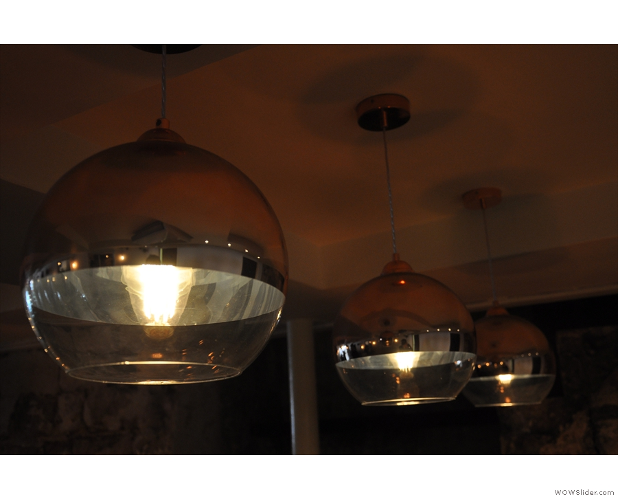 There are also these amazing light-fittings over the copper-topped tables at the back.