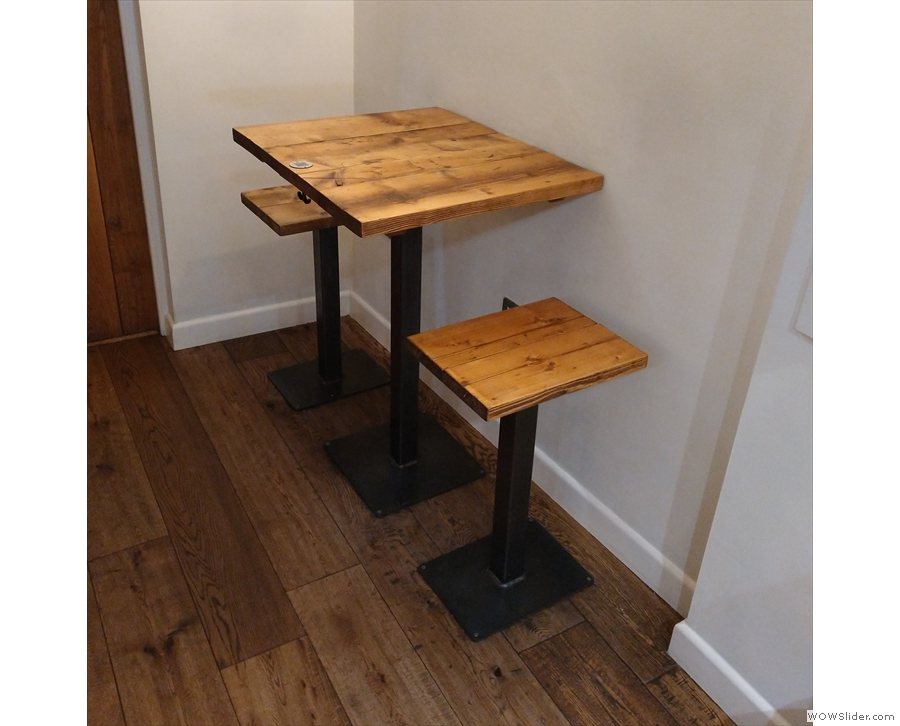 ... kitchen, next to which is this solitary two-person table tucked away in the corner.
