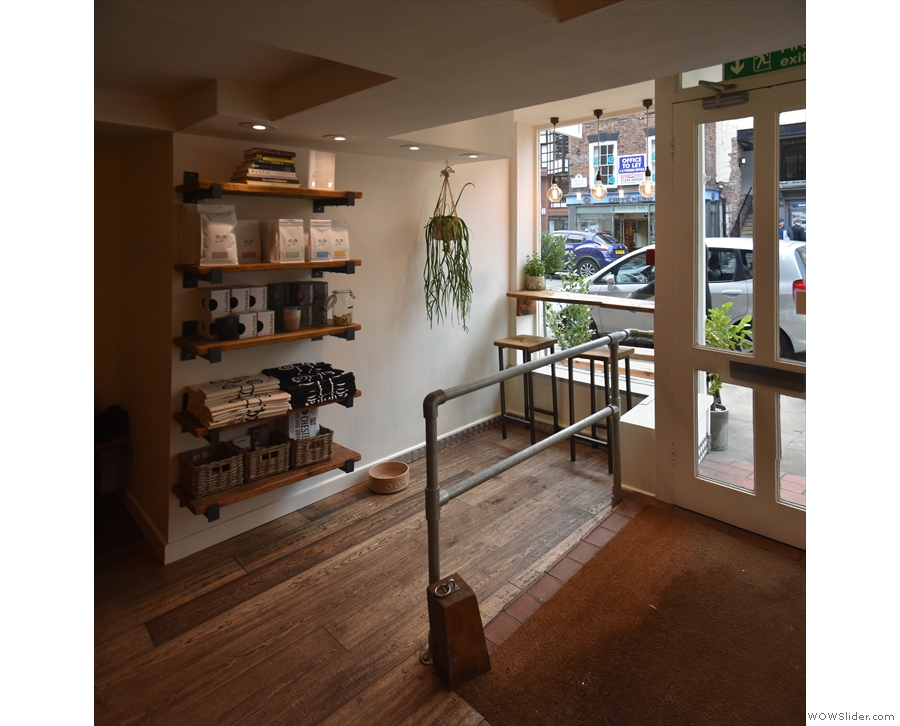 You can sit on the right (of the door), tucked away past the retail shelves...
