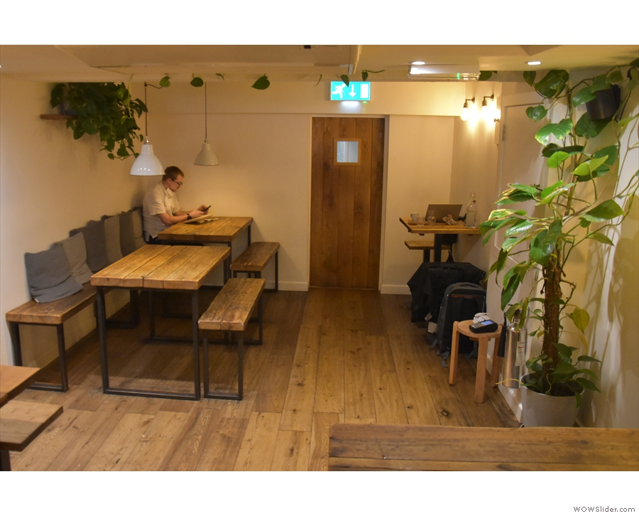 There's a final seating area at the back. The toilet's to the left, while the door leads to...