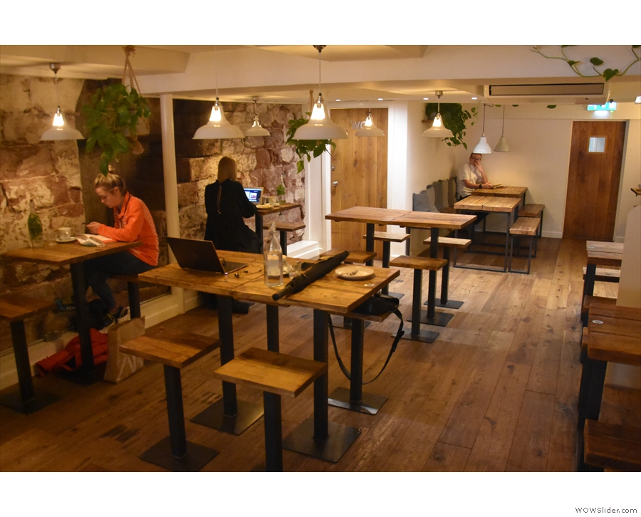 A short row of four-person tables runs down the centre, while on the left...