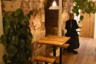 ... are a pair of two-person tables against the wall. Note the old stone staircase...