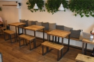 ... with more seating opposite, starting with these four tables, along benches by the wall...