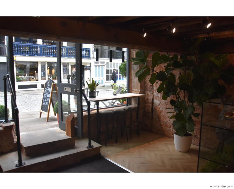 The windows bars are still either side of the door, although the large potted plant...