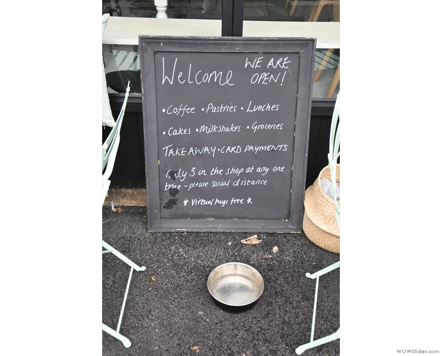 There's no A-board, but there is a sign, plus a bowl for dogs (who are allowed inside).