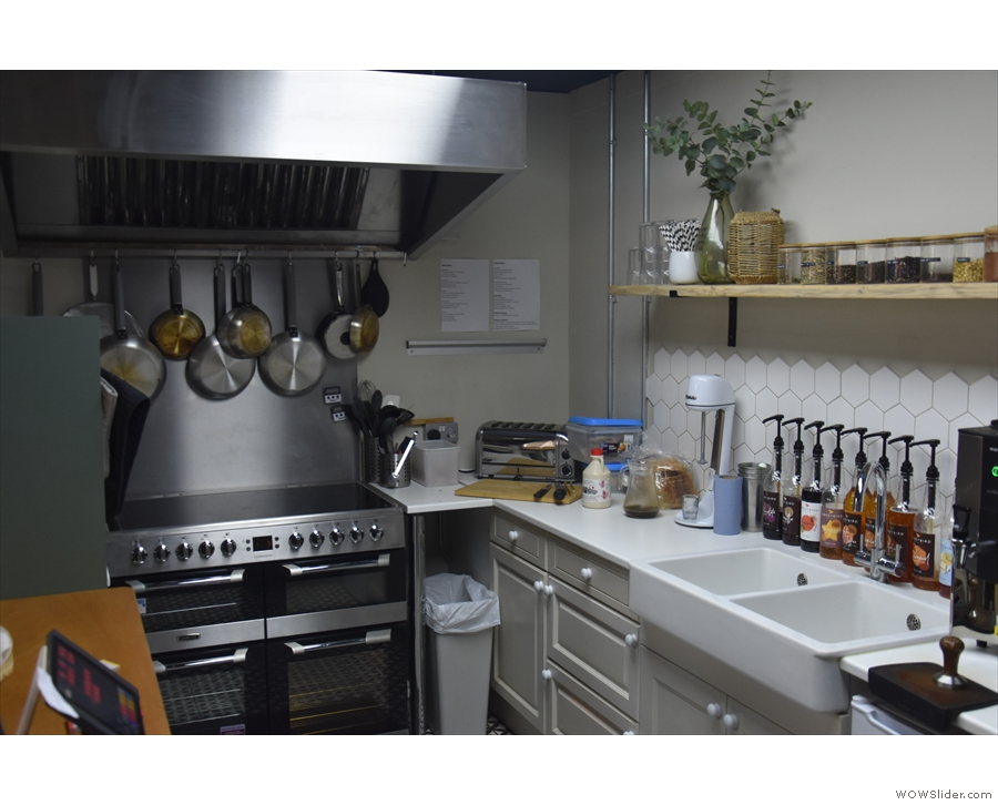 The kitchen, where all the food is cooked, is behind the counter, tucked away to the left.
