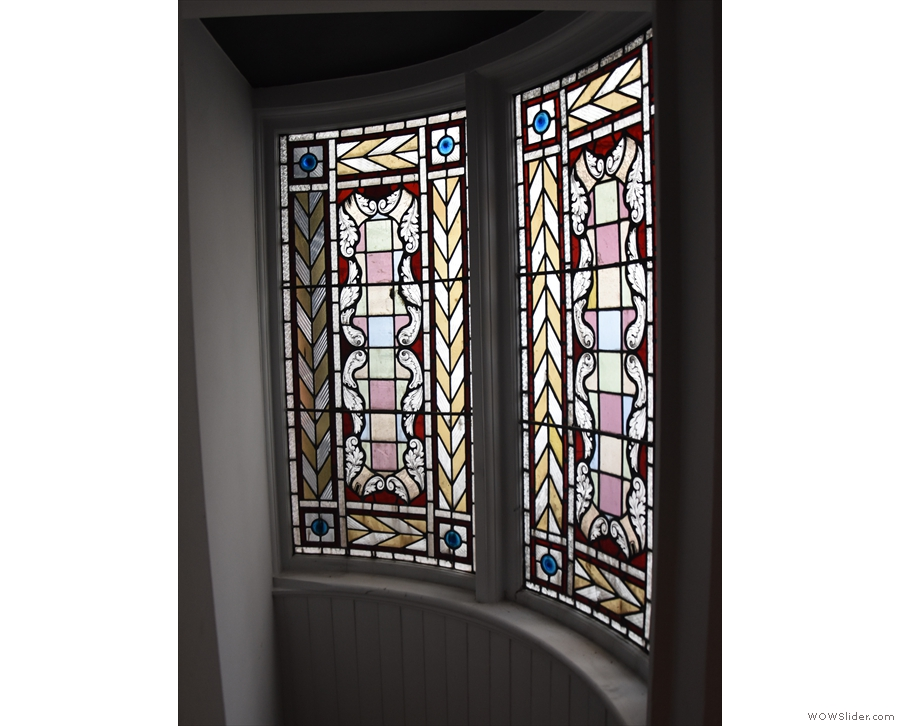 Even better, in a little alcove off to one side at the top of the stairs is this stained glass.