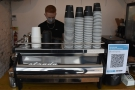 To business: one barista and his Strada espresso machine.
