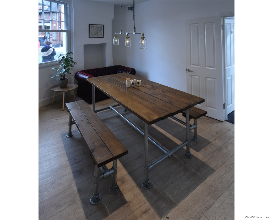 ... where you'll find this long, communal table opposite the counter.
