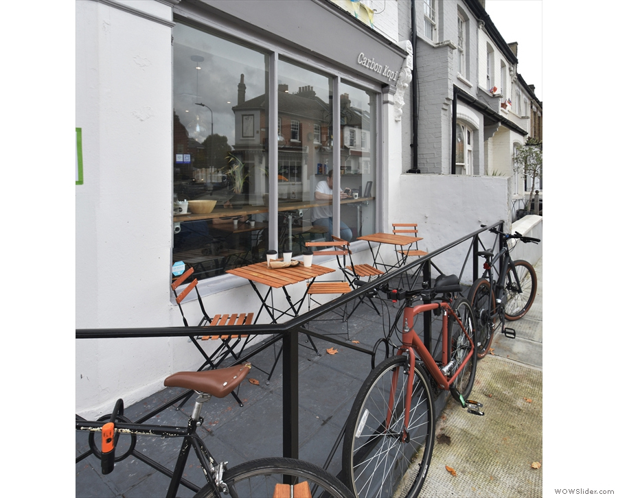 ... act as a bike rack, while separating a small seating area from the pavement.