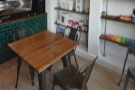 ... and completed with two of these three-person tables between it and the counter.