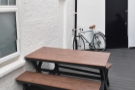 ... with three of these picnic-style tables, one against the back wall of Carbon Kopi...