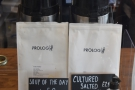 The batch brew options are to the right of the till, with two choices from guest roaster...