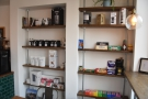 Carbon Kopi has a set of retail shelves built into the wall in front of the counter.