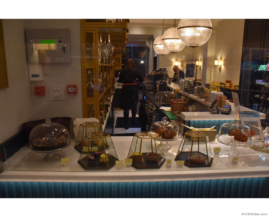 To business. You'll find the cakes at the front of the counter, next to which is a...